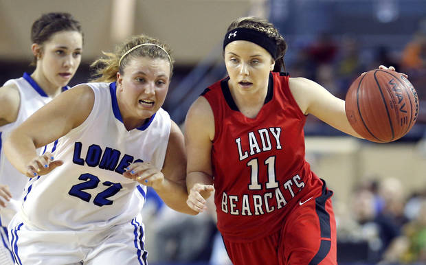 Erick's Maranda Janz dribbles up court as Lomega's Ashley LaGasse defends during the Class B girls state championship between Erick and Lomega at the State Fair Arena., Saturday, March 2, 2013.. Photo by Sarah Phipps, The Oklahoman