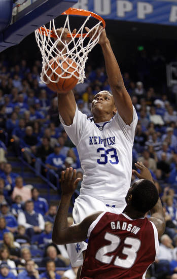 University of Kentucky's  Daniel  Orton (33) dunks over Rider's Novar Gadson during the first half of their NCAA college basketball game at Rupp Arena in Lexington, Ky., on Saturday, Nov. 21, 2009. (AP Photo/ James Crisp)