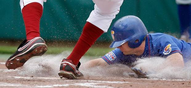 Kansas' David Narodowski steals home on a wild pitch during the college baseball game between the University of Kansas and the University of Oklahoma at L. Dale Mitchell Park, Sunday, May 3, 2009, in Norman, Okla. Photo by Sarah Phipps, The Oklahoman
