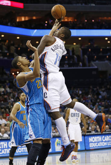 Charlotte Bobcats&#039; Michael Kidd-Gilchrist (14) shoots over New Orleans Hornets&#039; Anthony Davis (23) during the first half of an NBA basketball game in Charlotte, N.C., Saturday, Dec. 29, 2012. (AP Photo/Chuck Burton)