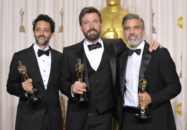 "Grant Heslov, from left, Ben Affleck, and George Clooney pose with their award for best picture for ""Argo"" during the Oscars at the Dolby Theatre on Sunday Feb. 24, 2013, in Los Angeles. (Photo by John Shearer/Invision/AP)"
