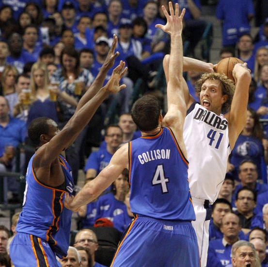 Oklahoma City's Serge Ibaka (9) and Nick Collison (4) defend Dirk Nowitzki (41) of Dallas  during game 2 of the Western Conference Finals in the NBA basketball playoffs between the Dallas Mavericks and the Oklahoma City Thunder at American Airlines Center in Dallas, Thursday, May 19, 2011. Photo by Bryan Terry, The Oklahoman