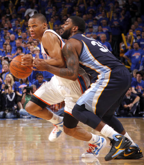 Oklahoma City's Russell Westbrook (0) tries to get by O.J. Mayo (32) of Memphis during game 7 of the NBA basketball Western Conference semifinals between the Memphis Grizzlies and the Oklahoma City Thunder at the OKC Arena in Oklahoma City, Sunday, May 15, 2011. Photo by Sarah Phipps, The Oklahoman