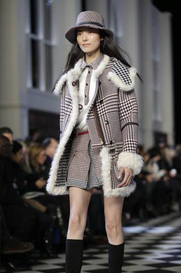 An outfit modeled on the runway in New York  for Tommy Hilfiger's fall 2013 collection. AP PHOTO