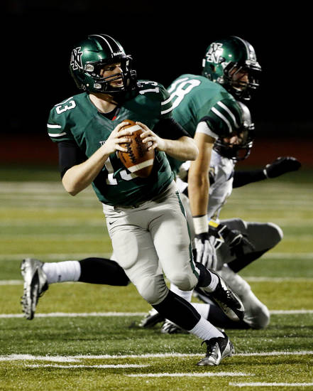 HIGH SCHOOL FOOTBALL PLAYOFFS: Timberwolf quarterback Peyton Gavras looks for a receiver as  Norman North plays Broken Arrow in Class 6A football on Friday, Nov. 16, 2012 in Norman, Okla.  Photo by Steve Sisney, The Oklahoman