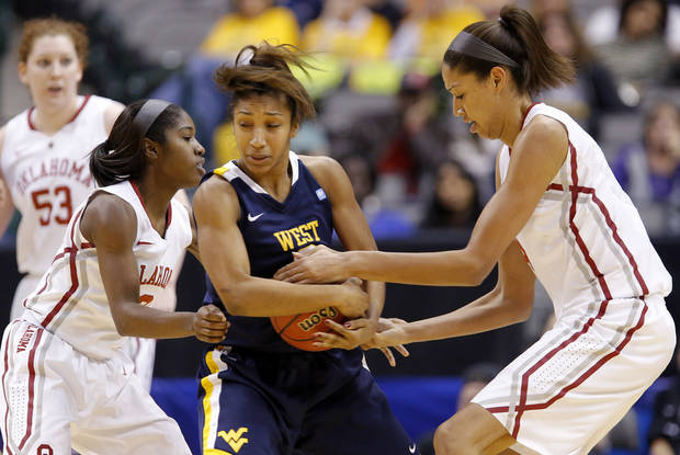 Taylor Palmer (2) fights with Oklahoma's Aaryn Ellenberg (3) and Nicole Griffin (4) for the ball during the Big 12 tournament women's college basketball game between the University of Oklahoma and West Virginia at American Airlines Arena in Dallas, Saturday, March 9, 2012.  Photo by Bryan Terry, The Oklahoman