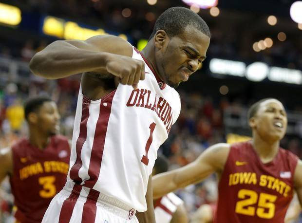 Oklahoma's Sam Grooms (1) reaches to a play during the Phillips 66 Big 12 Men's basketball championship tournament game between the University of Oklahoma and Iowa State at the Sprint Center in Kansas City, Thursday, March 14, 2013. Photo by Sarah Phipps, The Oklahoman
