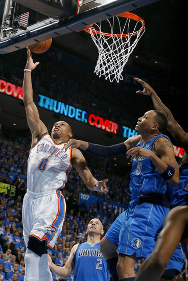 Oklahoma City's Russell Westbrook (0) shoots as Dallas' Shawn Marion (0) defends during game one of the first round in the NBA playoffs between the Oklahoma City Thunder and the Dallas Mavericks at Chesapeake Energy Arena in Oklahoma City, Saturday, April 28, 2012. Photo by Sarah Phipps, The Oklahoman