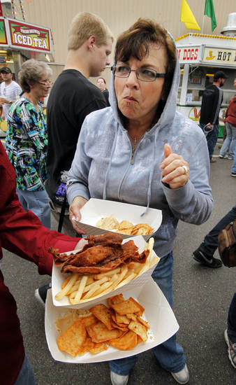 Jackie Porter, Oklahoma City, samples batter fried bacon during the 106th Oklahoma State Fair at State Fair Park on Saturday, Sept. 15, 2012, in Oklahoma City, Okla.  Photo by Steve Sisney, The Oklahoman