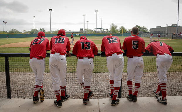 Verdigris players watch the game from the dugout during the 3A baseball semifinal game between Verdigris and Spiro on Friday, May 10, 2013, in Edmond, Okla.Photo by Chris Landsberger, The Oklahoman