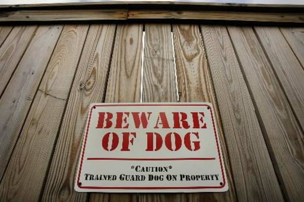 2007 file photo of a Beware of Dog sign posted on a privacy fence at a pit  bull kennel in Oklahoma City. By CHRIS LANDSBERGER,