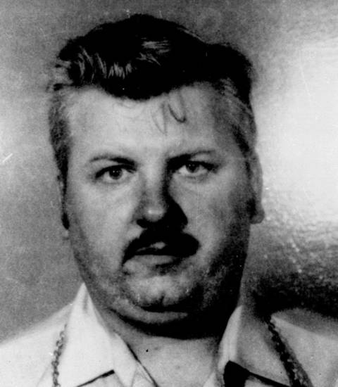 FILE - This 1978 file photo shows serial killer John Wayne Gacy. Three vials of  Gacy's blood were recently discovered by Cook County Sheriff's detective Jason Moran. The sheriff�s office is creating DNA profiles from the blood of Gacy and other executed killers and putting them in a national DNA database of profiles created from blood, semen, or strands of hair found at crime scenes and on the bodies of victims. What they hope to find is evidence that links the long-dead killers to the coldest of cold cases and prompt authorities in other states to submit the DNA of their own executed inmates and maybe evidence from decades-old crime scenes to help them solve their own cases. (AP Photo)