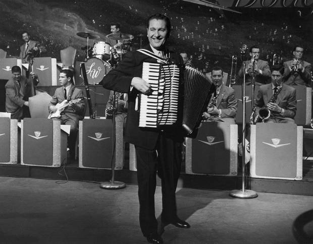FILE - In this undated 1958 file photo Lawrence Welk leads his big band. The State Historical Society of North Dakota is considering buying Welk's boyhood home near the south-central North Dakota town of Strasburg to be used as a tourist destination to tout the importance of agriculture and the region's German-Russian heritage. (AP Photo/File)