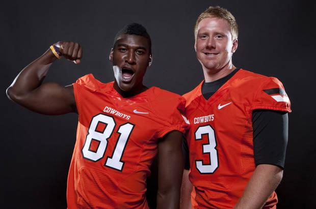 **FOOTBALL TAB DO NOT USE***       OKLAHOMA STATE UNIVERSITY / OSU / COLLEGE FOOTBALL: Oklahoma State's Brandon Weeden (3) and Justin Blackmon (81) pose a photo during Oklahoma State's Football media day in Stillwater, Okla., Saturday, Aug. 6, 2011. Photo by Sarah Phipps, The Oklahoman ORG XMIT: KOD