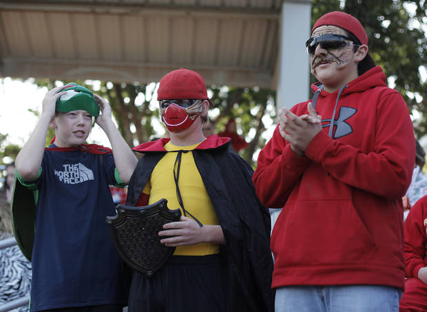 Jake McCoure, 13, and Jordan Campbell, 14, and Seth Cody, 12, of Dale, watch from the stands during the Class A State Baseball semifinal game between Dale and Silo in Edmond, Okla., Friday, Oct. 5, 2012.  Photo by Garett Fisbeck, The Oklahoman