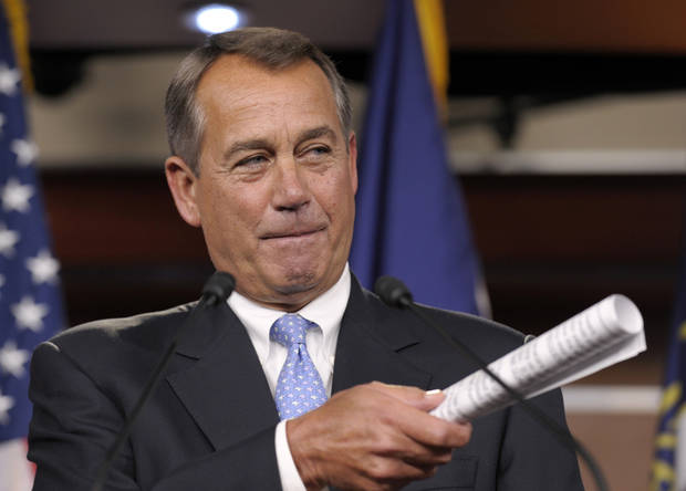 FILE - This Nov. 9, 2012 file photo shows House Speaker John Boehner of Ohio gesturing during a news conference on Capitol Hill in Washington. It's entirely possible that lawmakers and the White House will reach a deal to avert an avalanche of tax increases and deep cuts in government programs before a Jan. 1 deadline. To do so, however, they'll have to resolve serious political and fiscal dilemmas that have stymied them time after time, despite repeated vows to overcome them. (AP Photo/Susan Walsh, File)