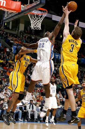 Oklahoma City's Kevin Green (22) fights Indiana's Brandon Rush (25) and A.J. Price (3) for a rebound during the basketball game between the Oklahoma City Thunder and the Indiana Pacers, Saturday, Jan. 9, 2010 at the Ford Center in Oklahoma CIty. Photo by Sarah Phipps, The Oklahoman