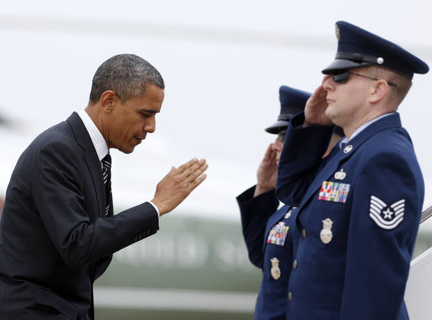 <p>President Barack Obama salutes as he boards Air Force One, Thursday, Nov. 15, 2012, at Andrews Air Force Base, Md., en route to New York to visit areas devastated by Superstorm Sandy. (AP Photo/Carolyn Kaster)</p>