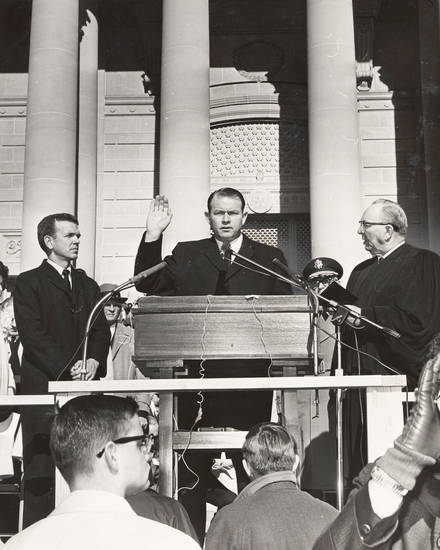 Flanked by Judge Ross Rizley, right, and  George Nigh, Henry Bellmon is sworn in as governor in 1963. OKLAHOMAN ARCHIVE PHOTO