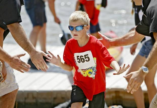 Matthew Davis, 11, starts the running portion of an Oklahoma City River Sport Challenge race during the USA Canoe/Kayak Sprint National Championships on the Oklahoma River in Oklahoma City, Saturday, August 28, 2010.  Photo by Bryan Terry, The Oklahoman ORG XMIT: KOD