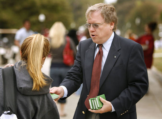 James Howell, Edmond and a member of the Christian group Gideons International, passes out free New Testaments on the campus of the University of Oklahoma in Norman, Oklahoma on Wednesday October 18, 2006.   Photo by Steve Sisney/The Oklahoman