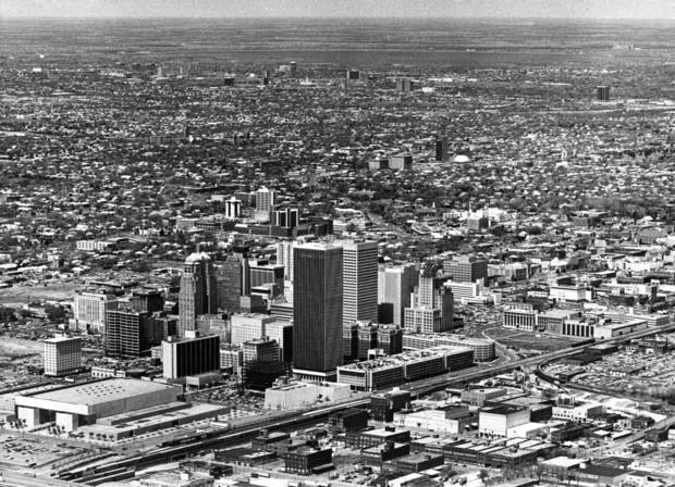 OKLAHOMA CITY / SKYLINE / AERIAL VIEW:  Aerial view of Oklahoma City looking northwest from the southeast.  Myriad Convention Center is at lower left corner; Bricktown area is in lower right corner.  Oklahoma Publishing Company complex can be seen at lower right. Staff photo dated 7/18/1980.