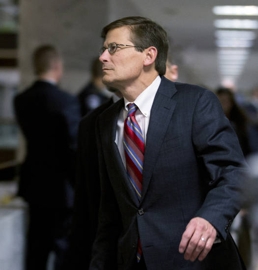 Acting CIA Director Michael Morell, leaves a Senate Select Committee on Intelligence closed oversight hearing into the circumstances surrounding the deadly attack on the U.S. Consulate in Benghazi, Libya, on Capitol Hill in Washington, Thursday, Nov. 15, 2012. (AP Photo/Manuel Balce Ceneta)