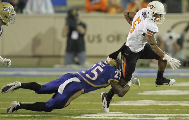 Oklahoma State's Josh Stewart (5) tries to get past Tulsa's Ja'Terian Douglas (25) during a college football game between the Oklahoma State University Cowboys and the University of Tulsa Golden Hurricane at H.A. Chapman Stadium in Tulsa, Okla., Sunday, Sept. 18, 2011. Photo by Chris Landsberger, The Oklahoman