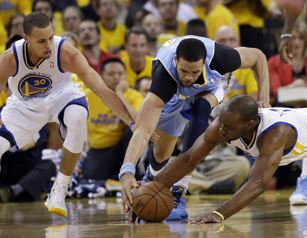 From left, Golden State Warriors' Stephen Curry, Denver Nuggets' JaVale McGee and Warriors' Carl Landry reach for a loose ball during the first half of Game 6 in a first-round NBA basketball playoff series in Oakland, Calif., Thursday, May 2, 2013. (AP Photo/Marcio Jose Sanchez)