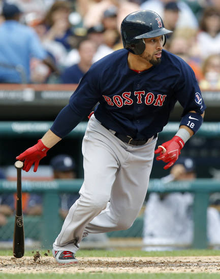 Boston Red Sox's Shane Victorino singles to drive in teammates Jose Iglesias and Jacoby Ellsbury against the Detroit Tigers in the fourth inning during a baseball gameon Friday, June 21, 2013, in Detroit. Victorino had a home run and five RBIs in the Red Sox's 10-6 win. (AP Photo/Duane Burleson)