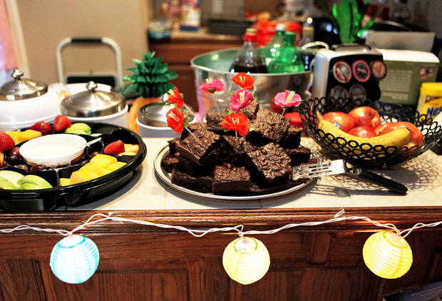 "Island-themed decorations and food are displayed during a ""Lost"" series finale watch party at the Moore home of Alex and Amber Gates.  Photo by John Clanton, The Oklahoman"