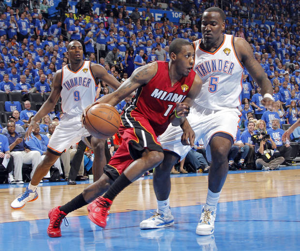 Miami's Mario Chalmers (15) drives past Oklahoma City's Kendrick Perkins (5) during Game 1 of the NBA Finals between the Oklahoma City Thunder and the Miami Heat at Chesapeake Energy Arena in Oklahoma City, Tuesday, June 12, 2012. Photo by Chris Landsberger, The Oklahoman