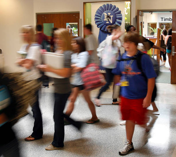 Students walk to class past a blue ribbon at Norman North High School in Norman, Oklahoma on Friday, Sept. 12, 2008.    BY STEVE SISNEY, THE OKLAHOMAN