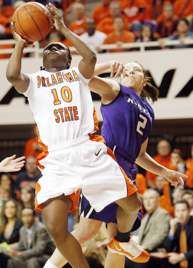 Oklahoma State's Andrea Riley (10) shoots in front of Kansas State's Brittany Chambers (2) in the second half during a women's NCAA college basketball game at Gallagher-Iba Arena in Stillwater, Okla., Saturday, Jan. 16, 2010. Oklahoma State won 66-56. (AP Photo/The Oklahoman, Nate Billings) ORG XMIT: OKOKL203
