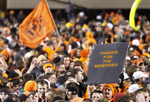 Fans celebrate the 44-10 win over the Sooners during the Bedlam college football game between the Oklahoma State University Cowboys (OSU) and the University of Oklahoma Sooners (OU) at Boone Pickens Stadium in Stillwater, Okla., Saturday, Dec. 3, 2011. Photo by Chris Landsberger, The Oklahoman