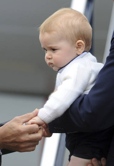 Britain's Prince George's hand is held by the New Zealand Governor General Sir Jerry Mateparae as his he left with his parents Prince William and Catherine, Duchess of Cambridge on an RAAF plane bound for Sydney, Wellington, New Zealand, Wednesday, April 16, 2014.   Wellington, New Zealand, Wednesday, April 016, 2014. (AP Photo/SNPA, Ross Setford) **NEW ZEALAND OUT**