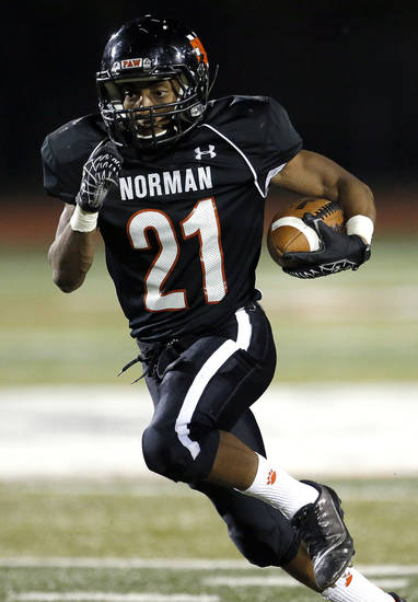 Norman's Imond Robinson rushes during the high school football game between Norman and Yukon at Norman High School in Norman, Okla., Thursday, Nov. 8, 2012. Photo by Sarah Phipps, The Oklahoman