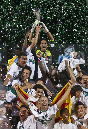 Santos goalkeeper Oswaldo Sanchez raises the trophy as he celebrates with teammates after defeating Monterrey 2-1 to win the last match of the Mexican national soccer league final in Torreon, Mexico, Sunday, May 20, 2012. (AP Photo/Christian Palma)