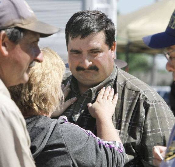 TORNADO / DEATH / CHILD / RECOVERY: Hank Hamil is comforted by a neighbor after hearing the news that the body of his missing three-year-old son Ryan Hamil had been found and recovered in Piedmont, OK, Thursday, May 26, 2011. Ryan has been missing since a tornado struck his family's home on Tuesday, May 24, 2011. By Paul Hellstern, The Oklahoman ORG XMIT: KOD