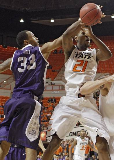 TCU's Garlon Green (33) and Oklahoma State's Kamari Murphy (21) battle for the ball during the college basketball game between Oklahoma State University Cowboys (OSU) and Texas Christian University Horned Frogs (TCU) at Gallagher-Iba Arena on Wednesday Jan. 9, 2013, in Stillwater, Okla. 