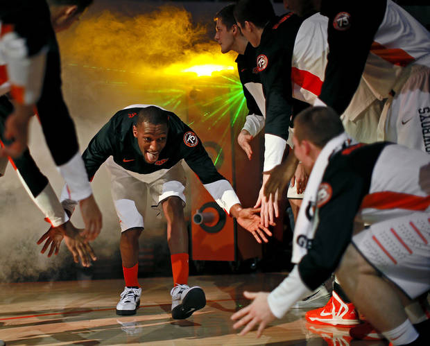Oklahoma State's Kamari Murphy is introduced before an NCAA college basketball game between Oklahoma State University (OSU) and TCU at Gallagher-Iba Arena in Stillwater, Okla., Wednesday, Jan. 15, 2014. Oklahoma State won 82-50. Photo by Bryan Terry, The Oklahoman