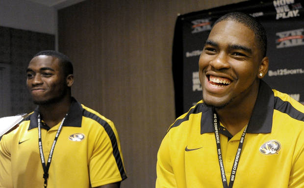 Missouri safety Kenji Jackson, left, and defensive lineman Jacquies Smith joke around between questions during NCAA college football Big 12 Media Days, Monday, July 25, 2011, in Dallas. (AP Photo/Matt Strasen)