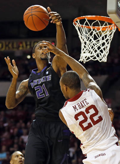 Kansas State's Jordan Henriquez (21) blocks the shot of Oklahoma's Amath M'Baye (22) during an NCAA men's basketball game between the University of Oklahoma (OU) and Kansas State at the Lloyd Noble Center in Norman, Okla., Saturday, Feb. 2, 2013. Kansas State won, 52-50. Photo by Nate Billings, The Oklahoman