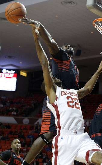 Oklahoma&#039;s Amath M&#039;Baye (22) has his shot blocked by Texas Tech&#039;s Kader Tapsoba (12) during an NCAA college basketball game between the University of Oklahoma and Texas Tech University at Lloyd Noble Center in Norman, Okla., Wednesday, Jan. 16, 2013. Photo by Bryan Terry, The Oklahoman