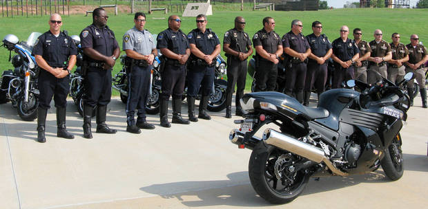 Motorcycle officers from Edmond, Oklahoma City, Tulsa, Broken Arrow and Oklahoma County sheriff�s office gather to promote safety for Monday�s national ride a motorcycle to work day. PHOTO BY DIANA BALDWIN, THE OKLAHOMAN