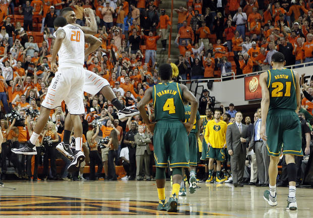 Oklahoma State 's Le'Bryan Nash (2) and Michael Cobbins (20) celebrate the 69-67 overtime win over Baylor during the college basketball game between the Oklahoma State University Cowboys (OSU) and the Baylor University Bears (BU) at Gallagher-Iba Arena on Wednesday, Feb. 5, 2013, in Stillwater, Okla. Photo by Chris Landsberger, The Oklahoman