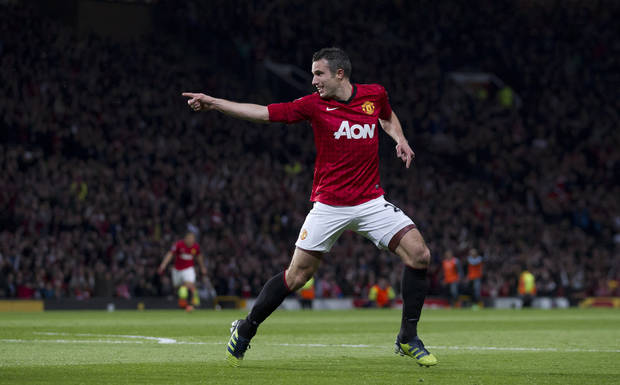 Manchester United's Robin van Persie celebrates after scoring his third goal against Aston Villa during their English Premier League soccer match at Old Trafford Stadium, Manchester, England, Monday April 22, 2013. (AP Photo/Jon Super)