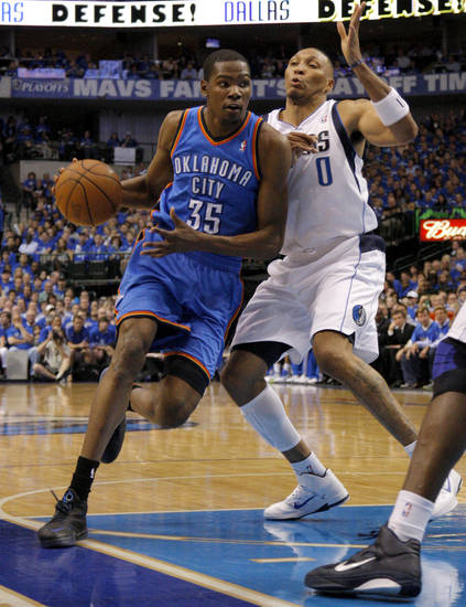 Oklahoma City's Kevin Durant (35) goes around Shawn Marion (0) of Dallas  during game 5 of the Western Conference Finals in the NBA basketball playoffs between the Dallas Mavericks and the Oklahoma City Thunder at American Airlines Center in Dallas, Wednesday, May 25, 2011. Photo by Bryan Terry, The Oklahoman