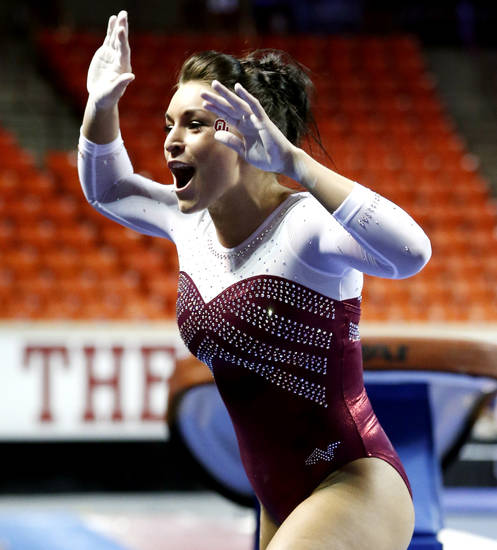 Madison Mooring celebrates her vault as the University of Oklahoma Sooners (OU) compete at the NCAA, Women's Gymnastics Regional at The Lloyd Noble Center on Saturday, April 6, 2013  in Norman, Okla. Photo by Steve Sisney, The Oklahoman