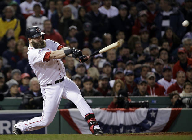 Boston Red Sox's Mike Napoli hits an RBI single during the fourth inning of Game 6 of baseball's World Series against the St. Louis Cardinals Wednesday, Oct. 30, 2013, in Boston. (AP Photo/David J. Phillip)